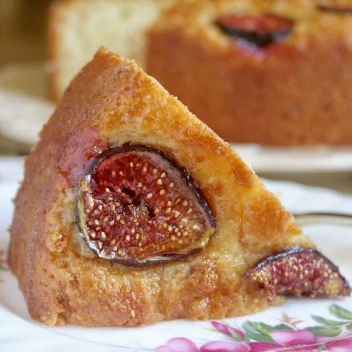slice of fig cake with cake in background