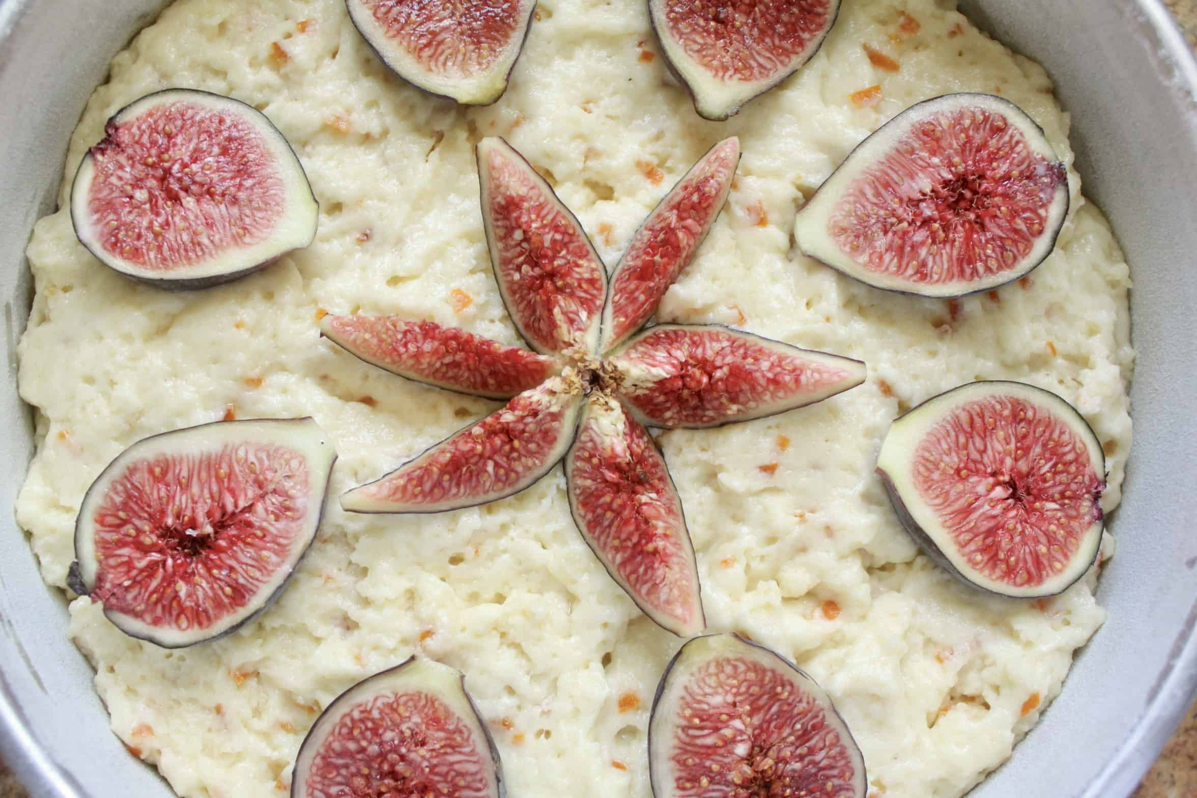 fresh figs decorating cake ready for the oven