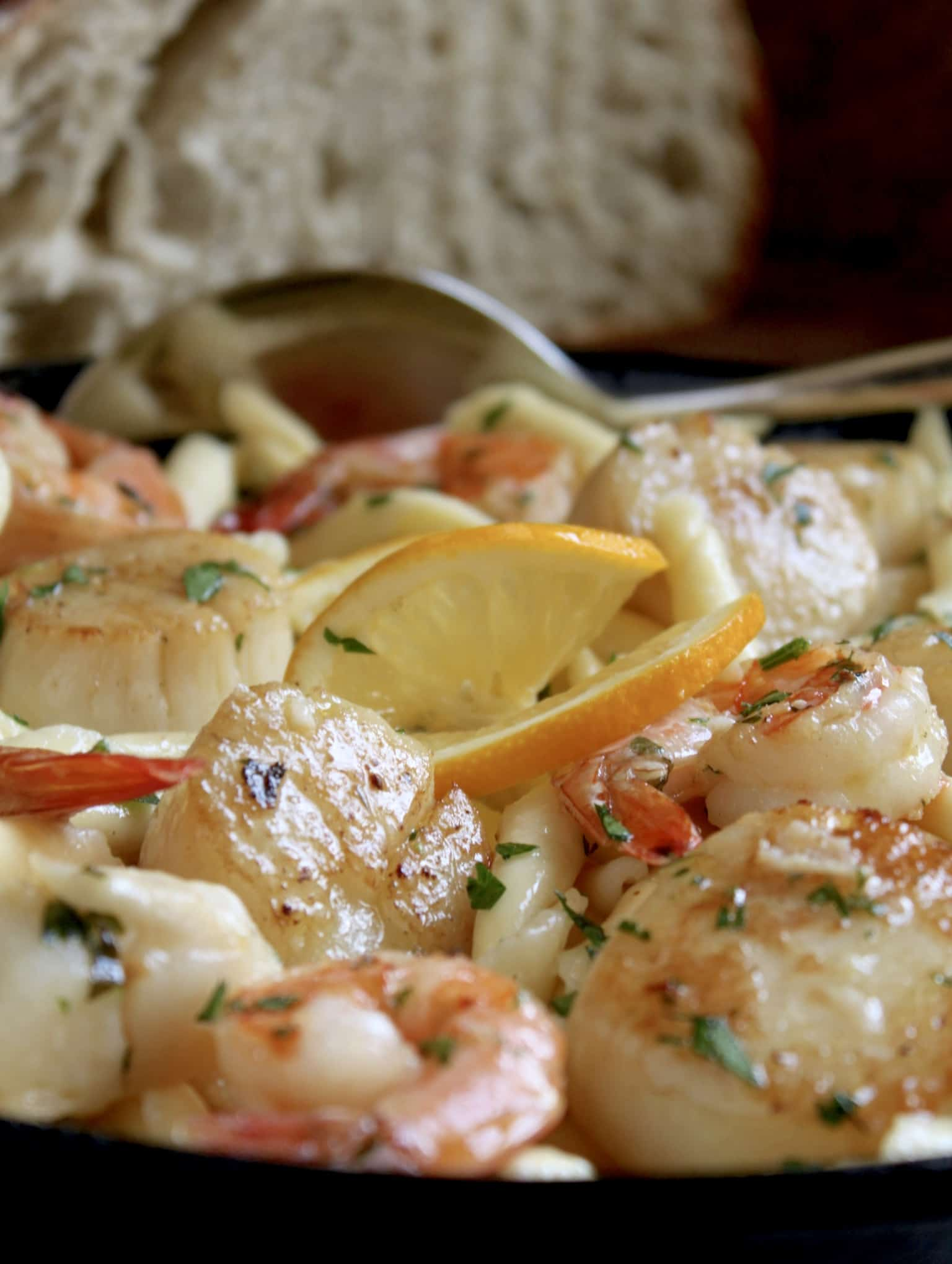 seafood pasta with shrimp and scallops in cast iron pan