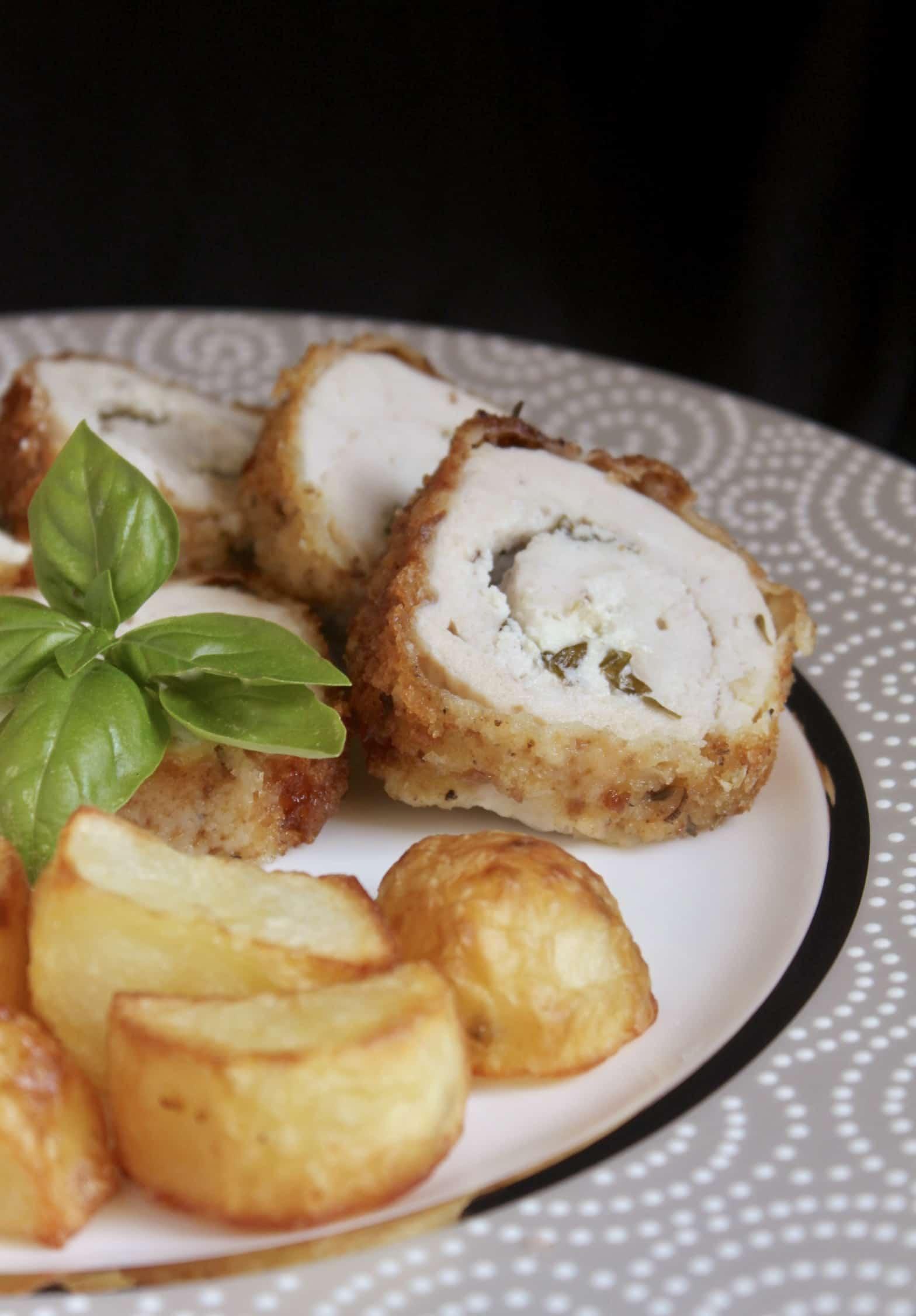 stuffed chicken breast fanned on a plate