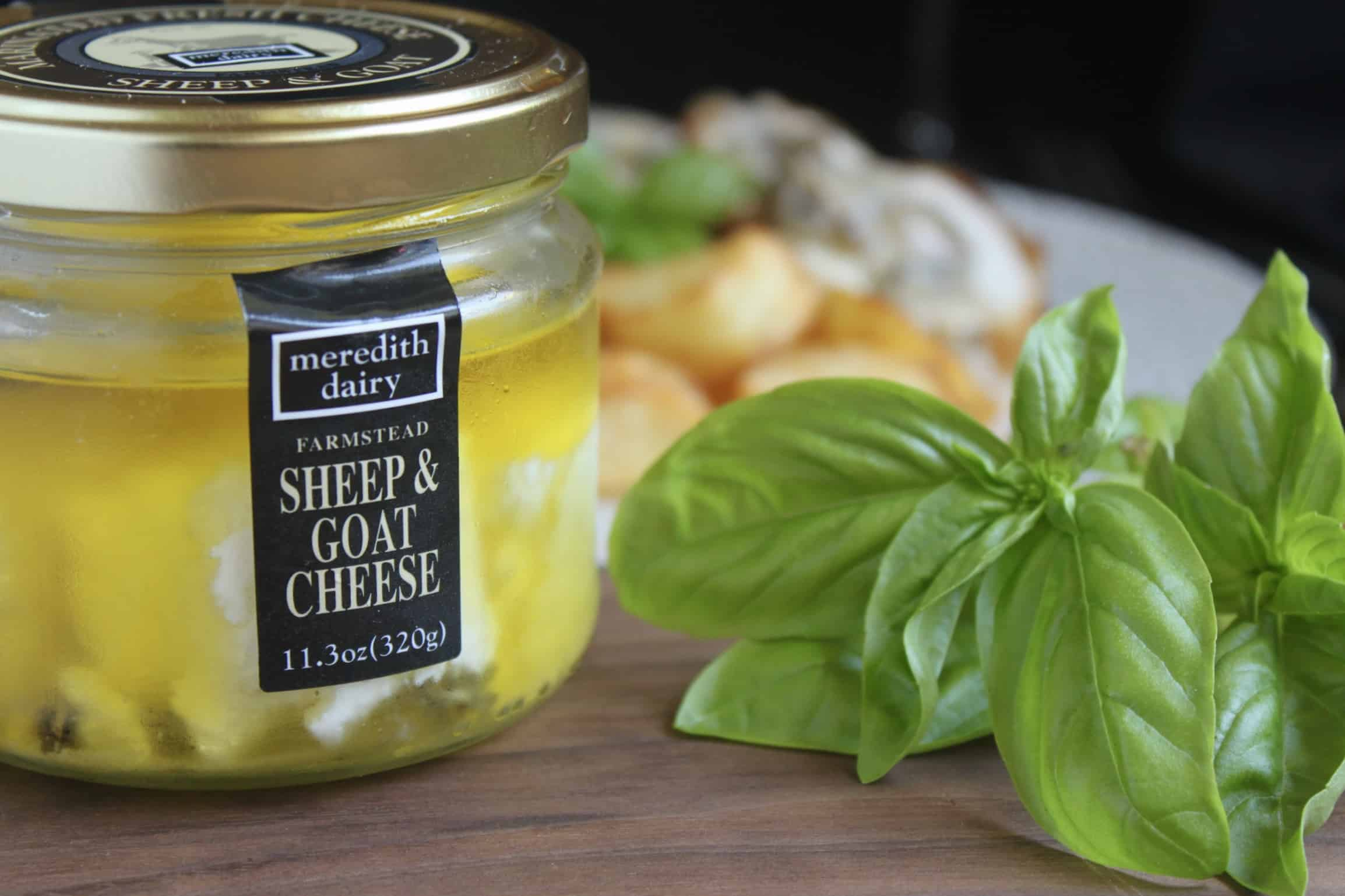 Meredith Dairy marinated goat cheese and basil leaves