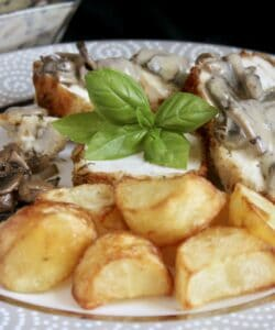 Stuffed Chicken Breast with Goat Cheese and basil and served with mushroom cream sauce and potatoes