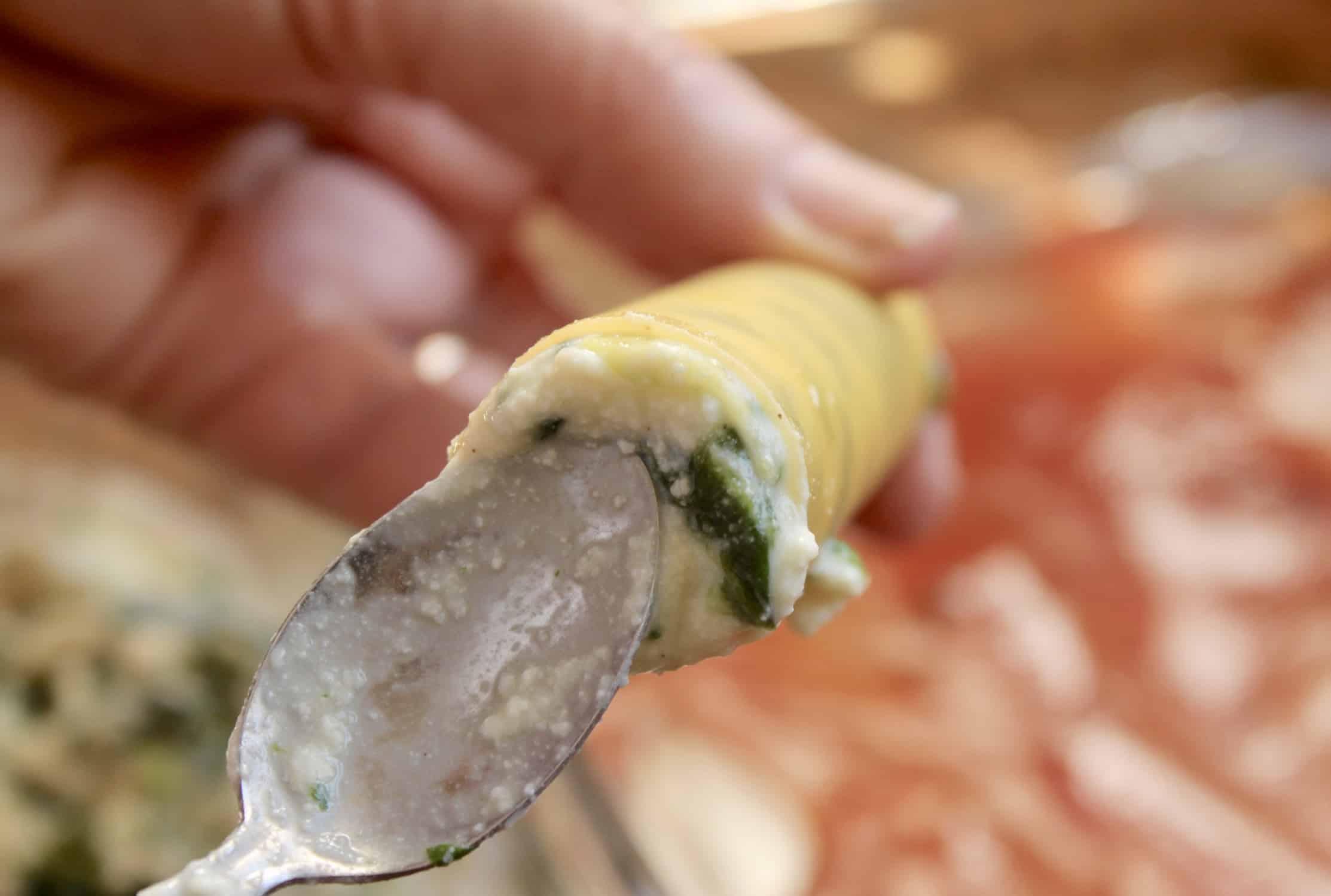 stuffing a manicotti shell