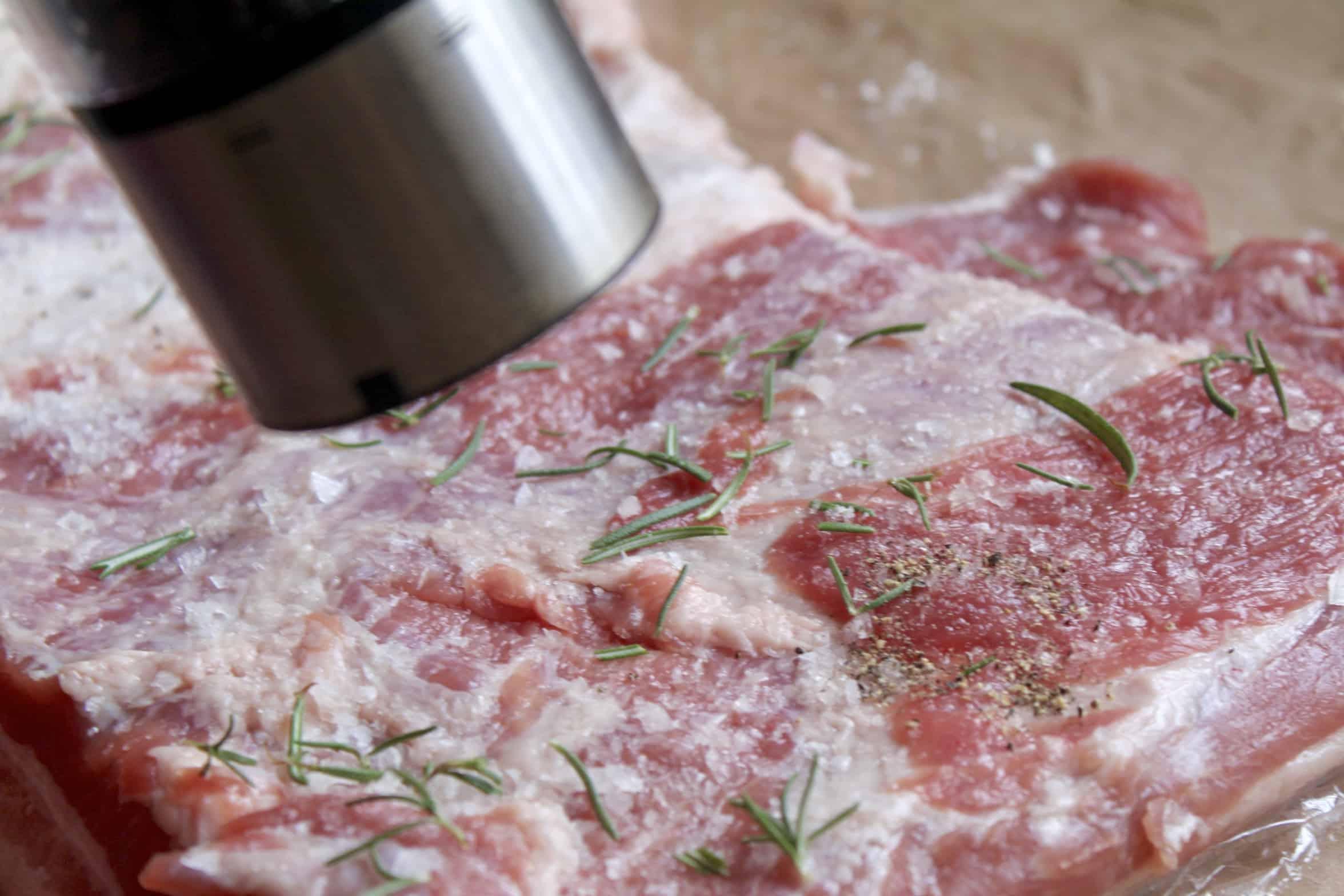 grinding pepper on the porchetta