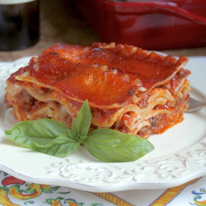 lasagna on a plate with an Italian napkin