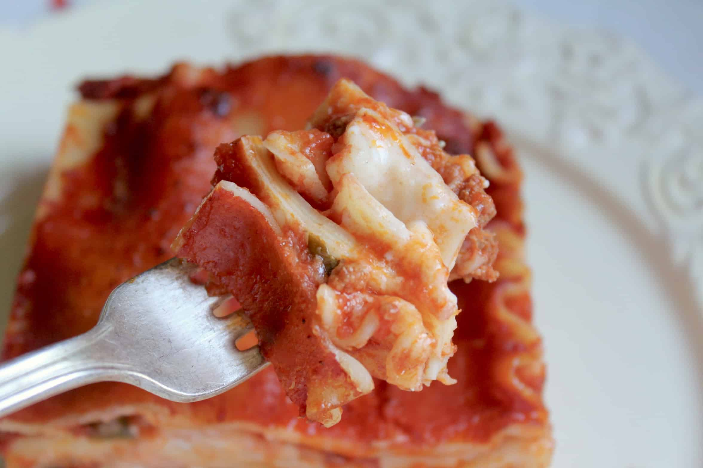 piece of lasagna on a fork