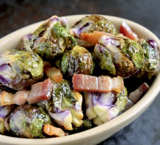 roasted brussel sprouts with pancetta in an oval dish