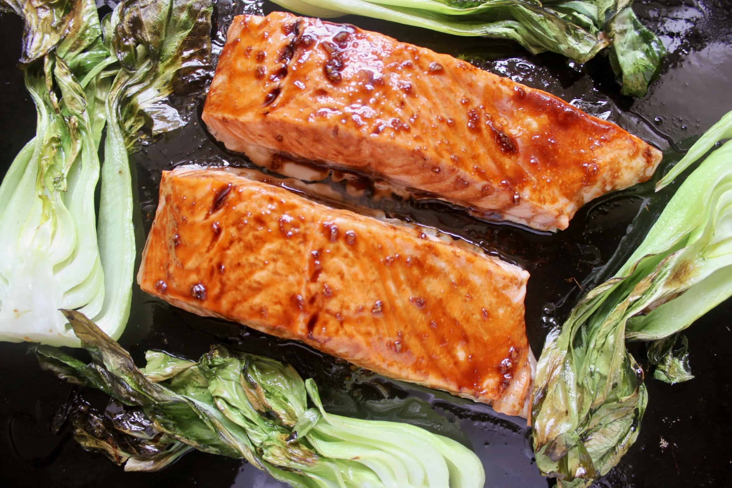 maple glazed salmon with bok choy on tray