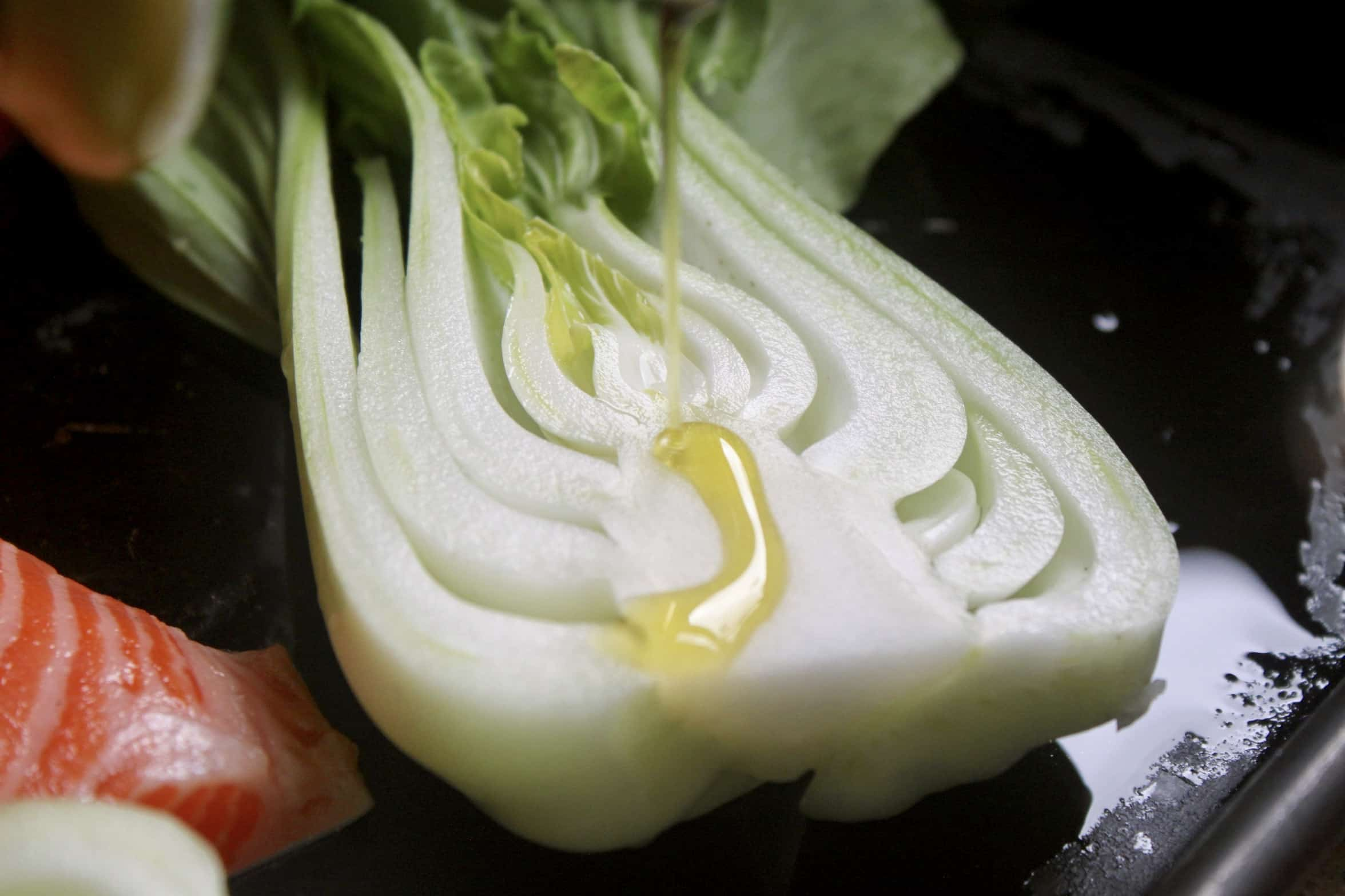 drizzling oil on bok choy
