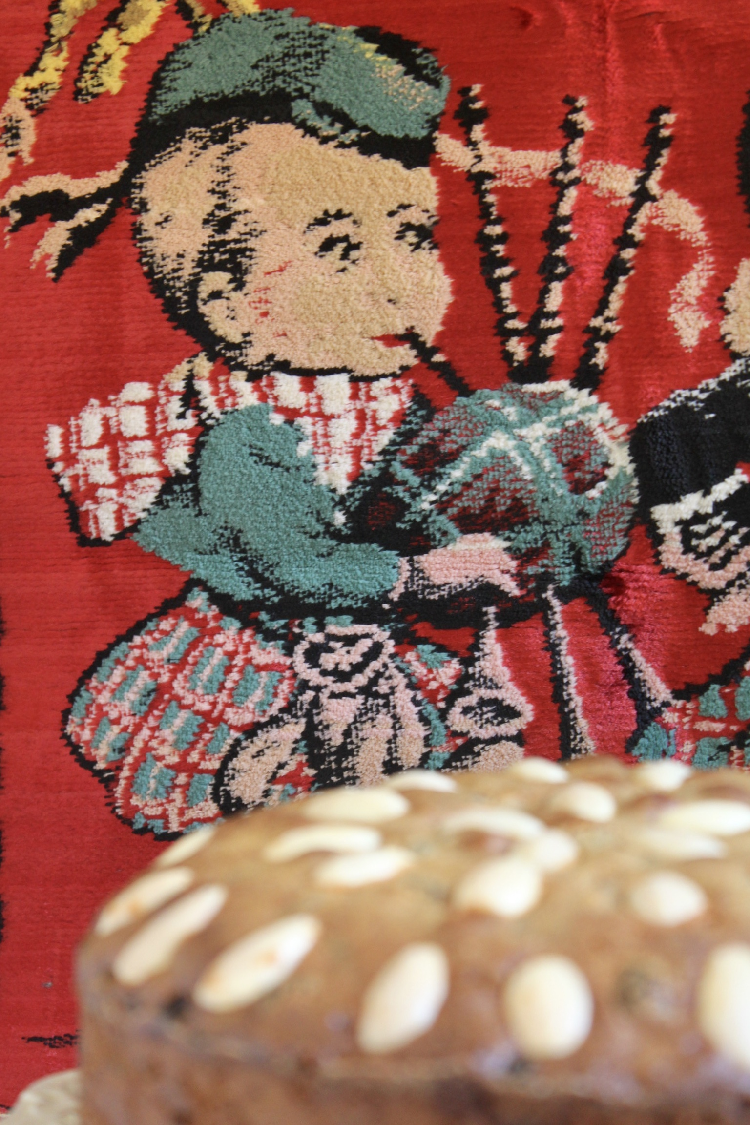 pillow of boy bagpiper with top of Dundee cake in the foreground