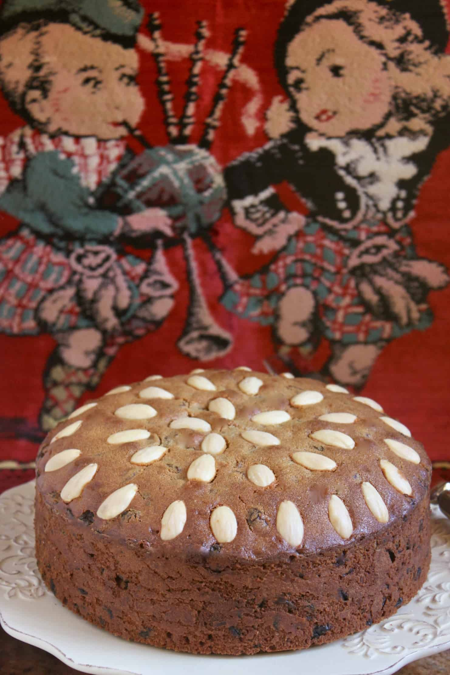 Dundee Cake with cute Scottish pillow in background