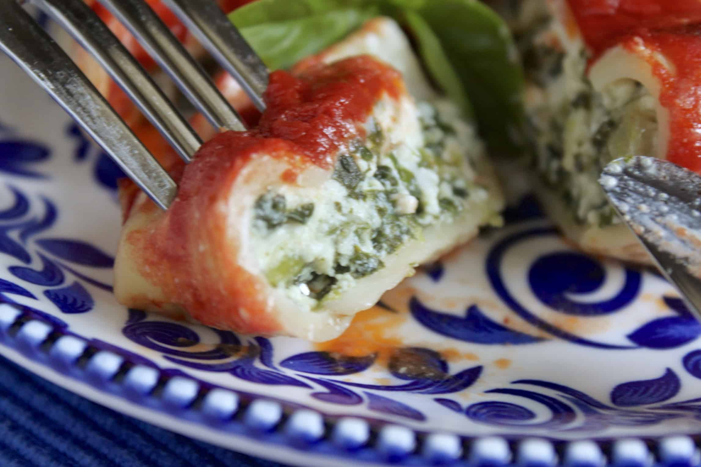 eating stuffed shells with spinach and ricotta