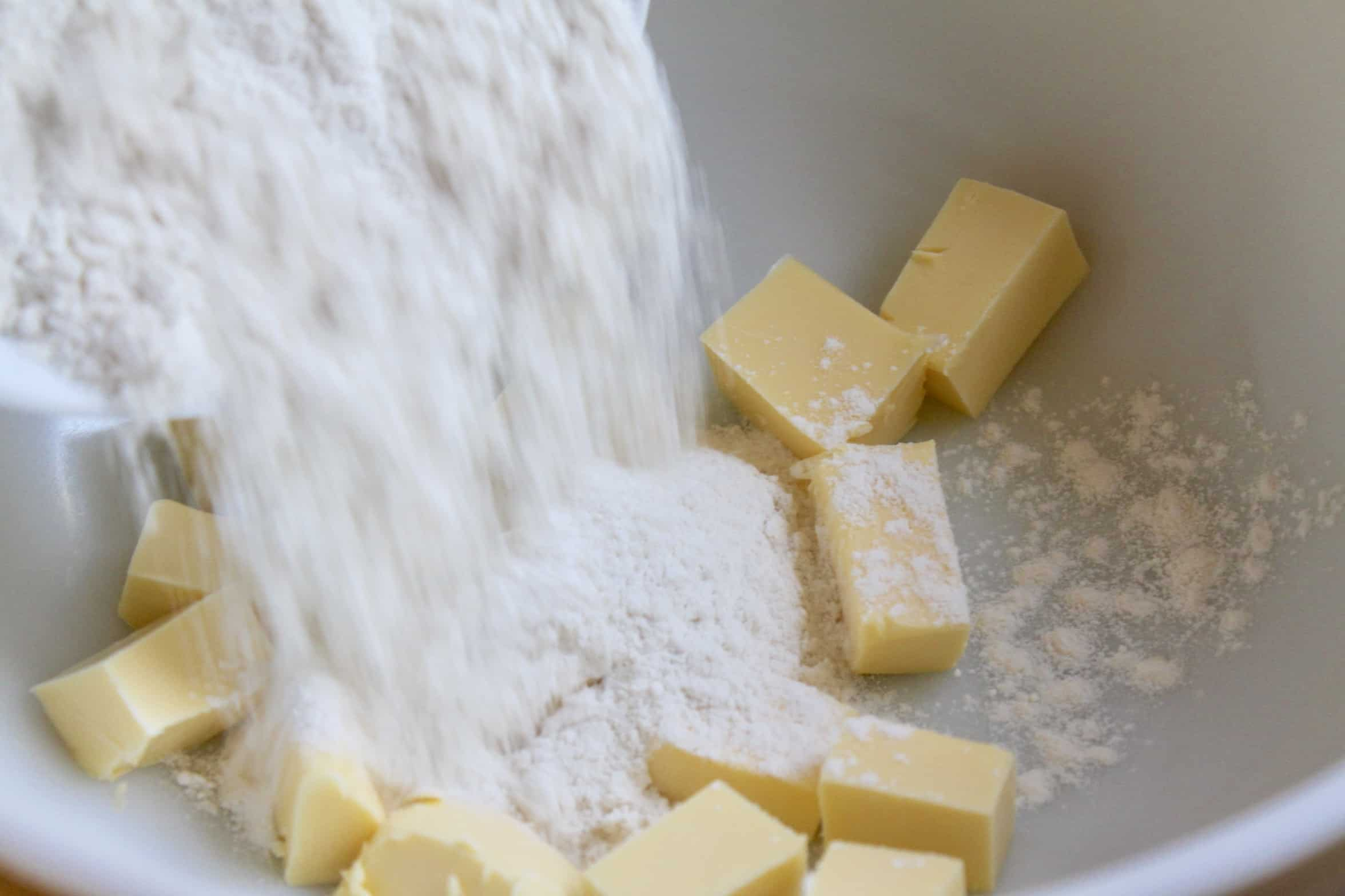 adding flour to butter