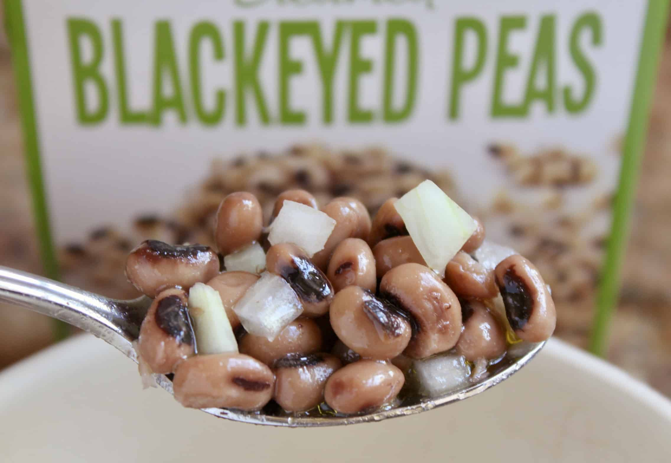 black eyed peas in a spoon with text