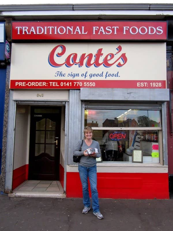 Christina in front of her dad's old fish and chip shop