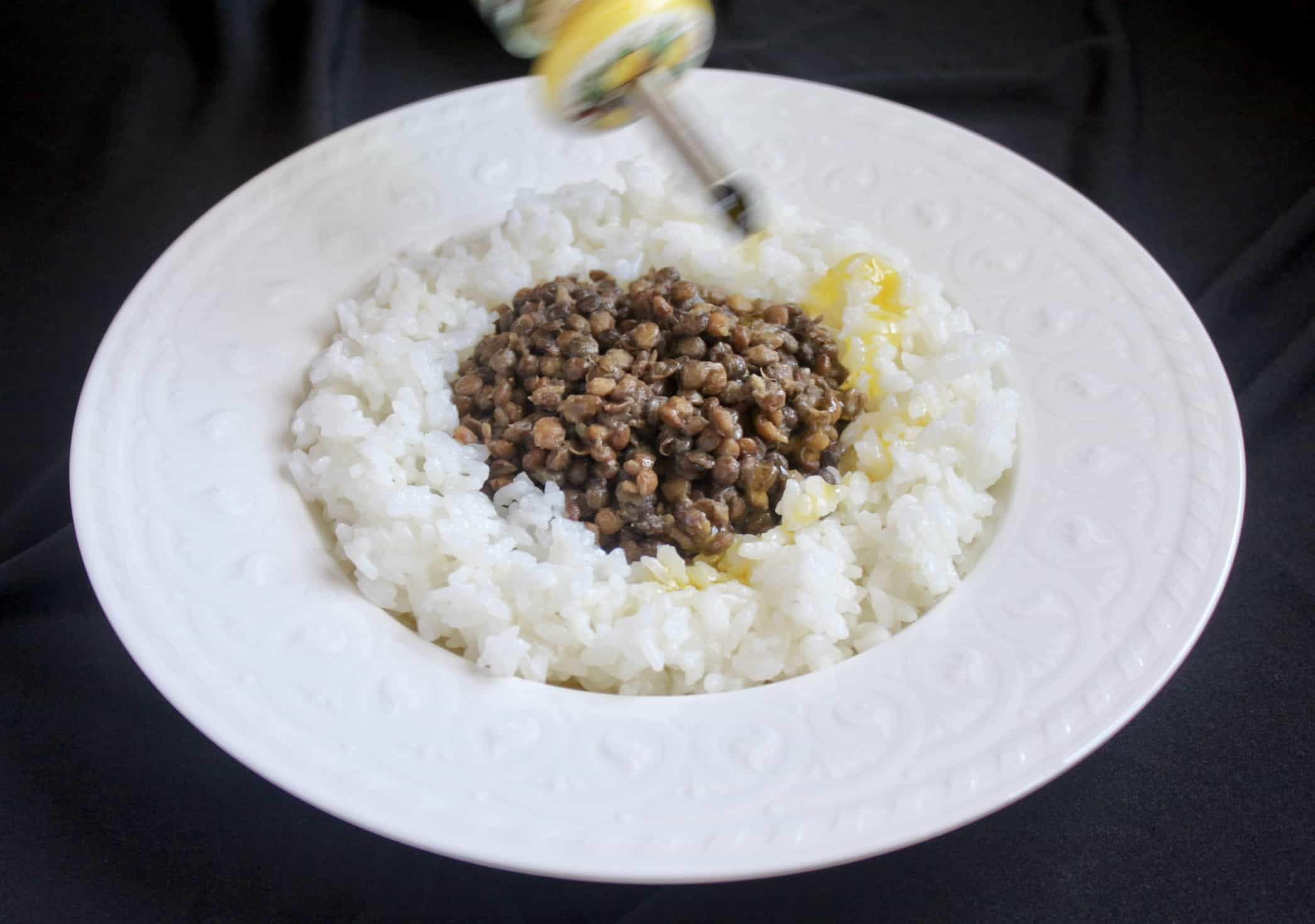drizzling oil on lentils and rice
