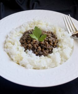 lentils and rice in a white bowl