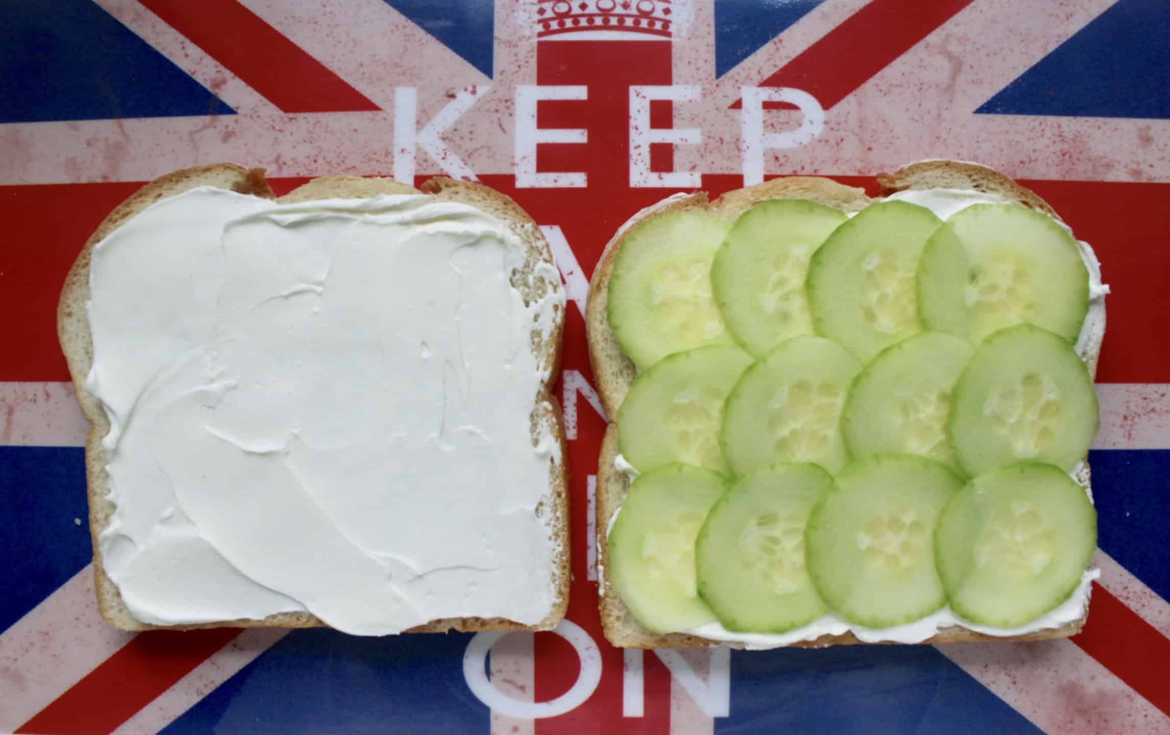 making a cucumber and cream cheese sandwich