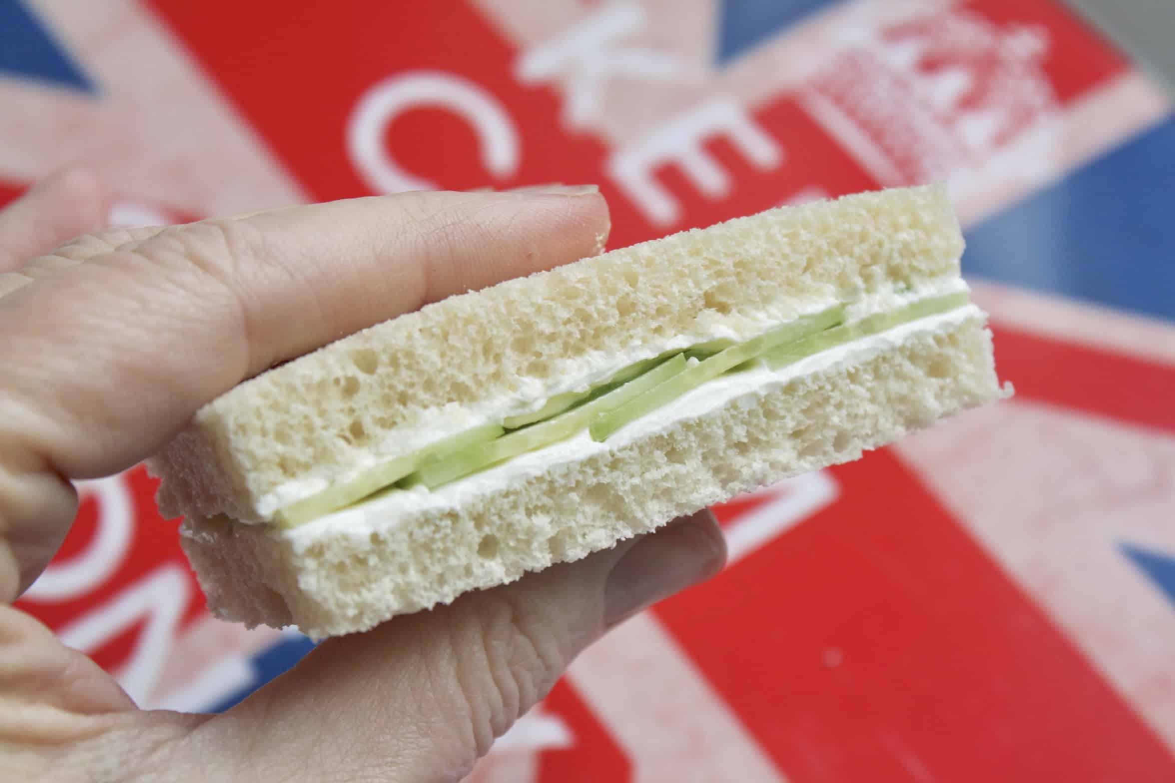 holding a cucumber sandwich