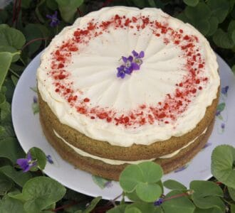 green cake in clover with flower