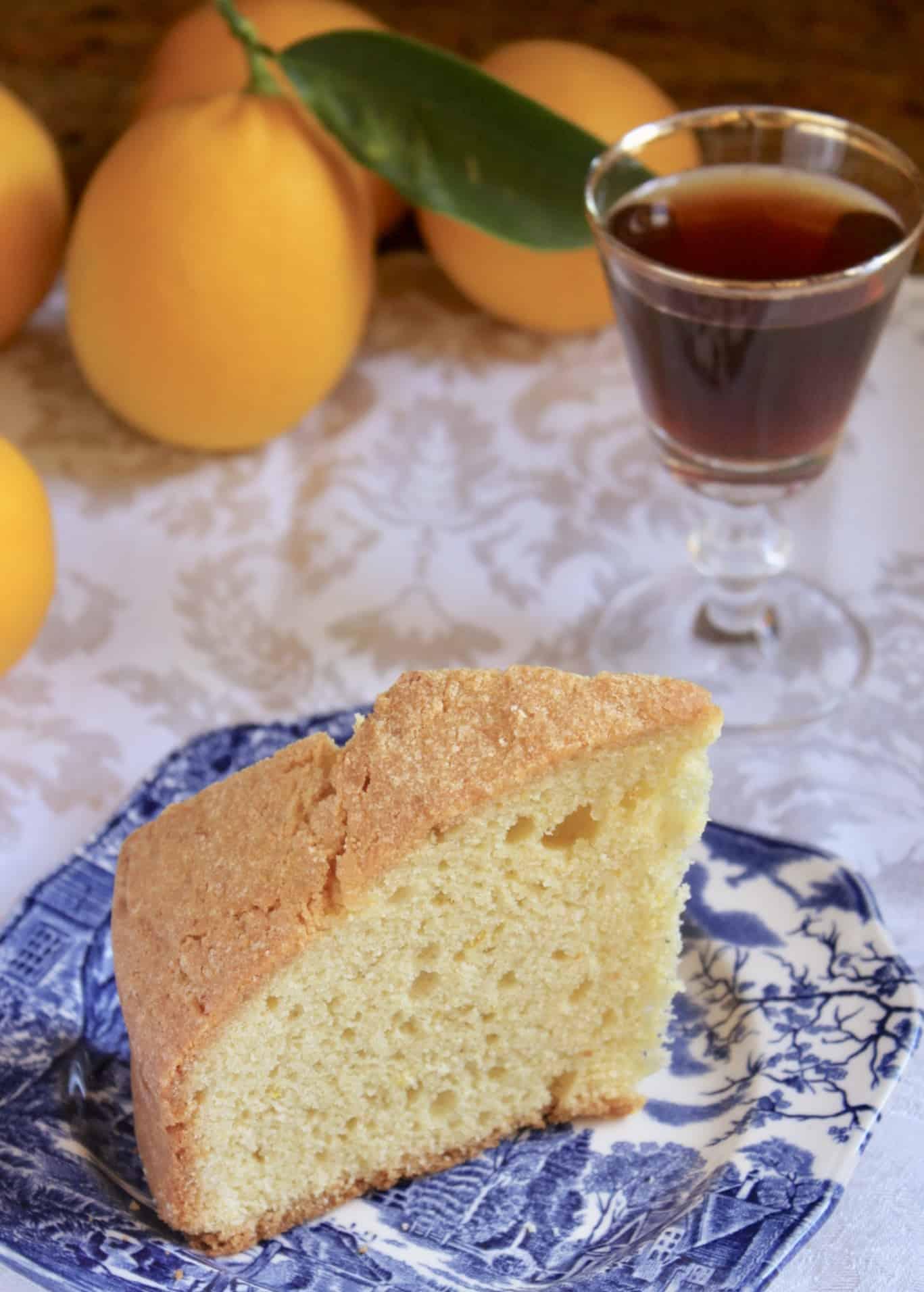 Madeira cake slice on plate with wine