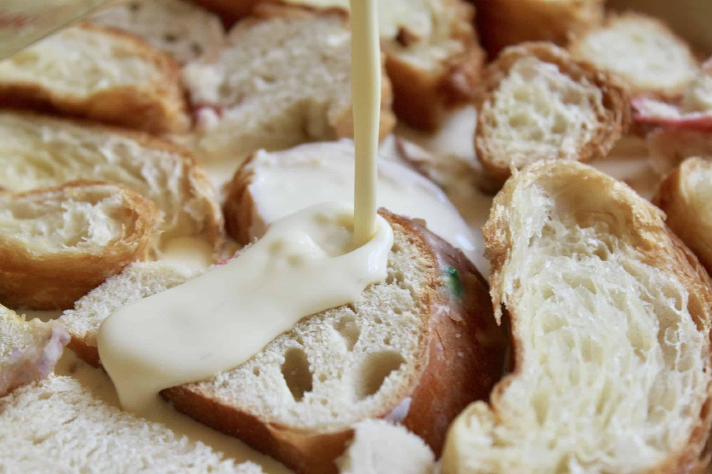 pouring custard over bread