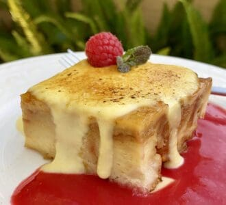 custard bread pudding with raspberry coulis