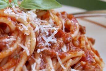 spaghetti sauce on pasta with cheese