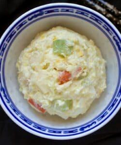 scoop of gamja salad in a bowl