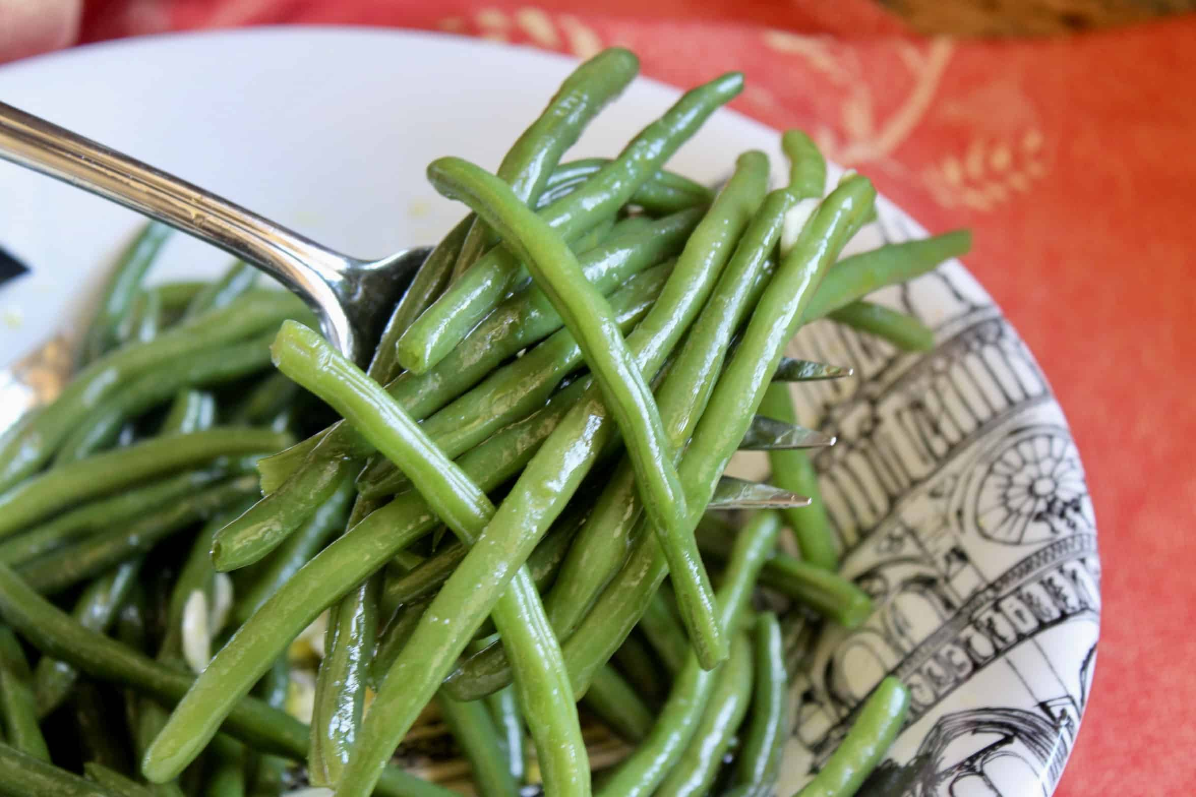 green bean salad on a serving fork