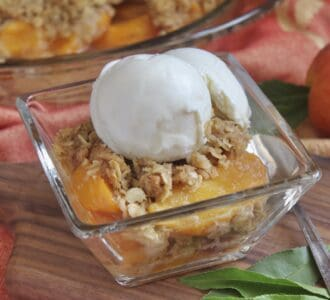 square glass bowl with peach dessert and ice cream