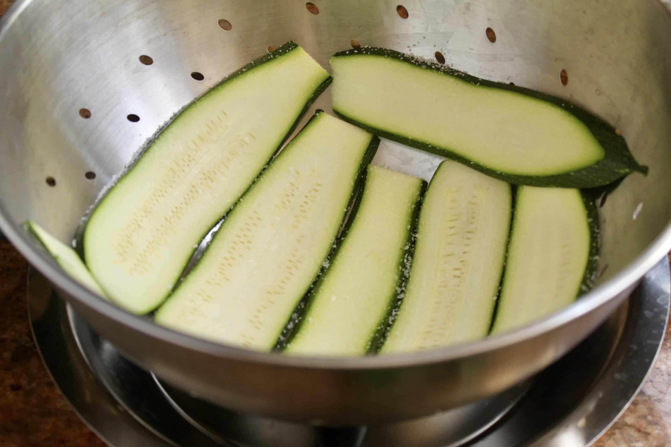 putting zucchini in a colander