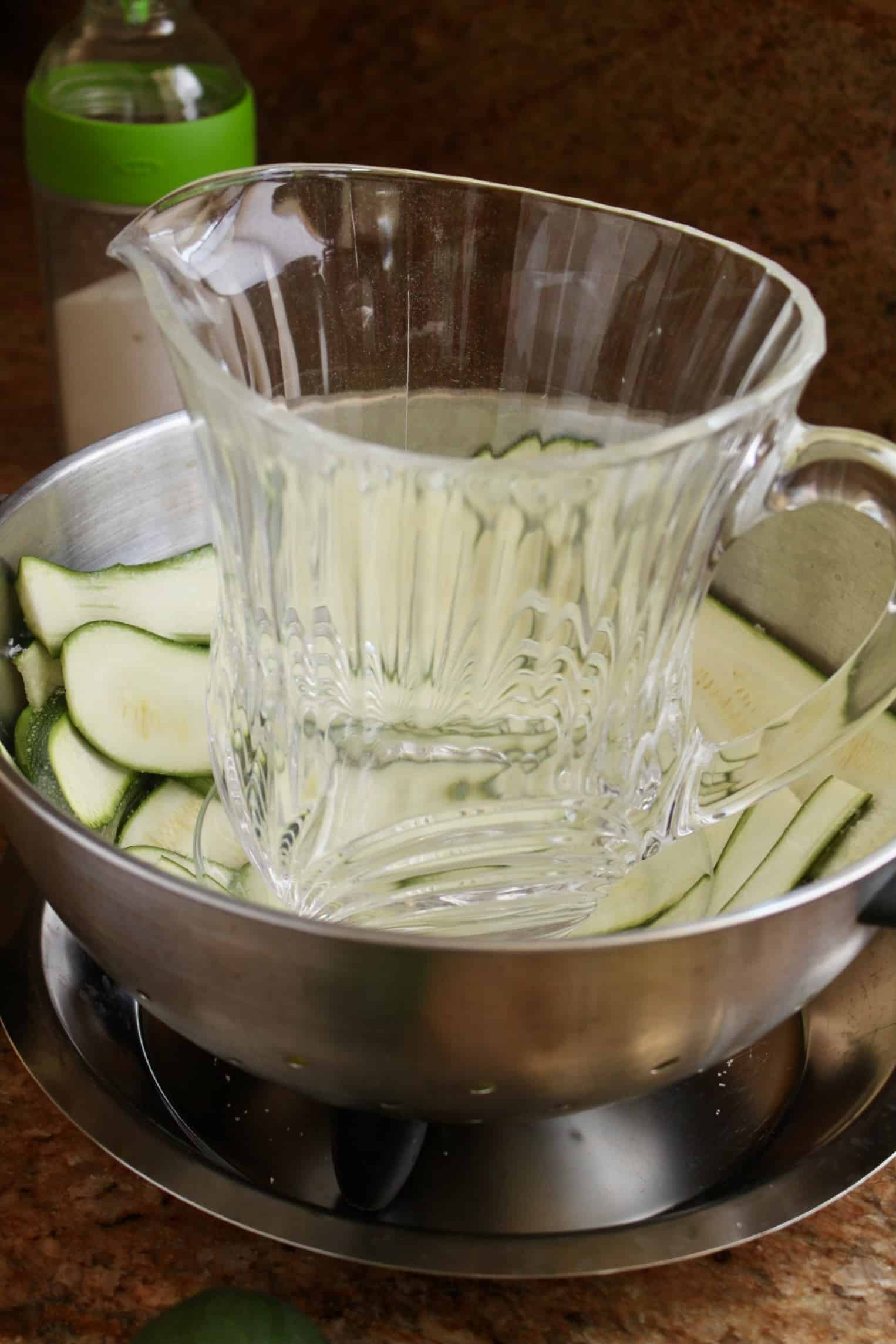 jug on zucchini slices