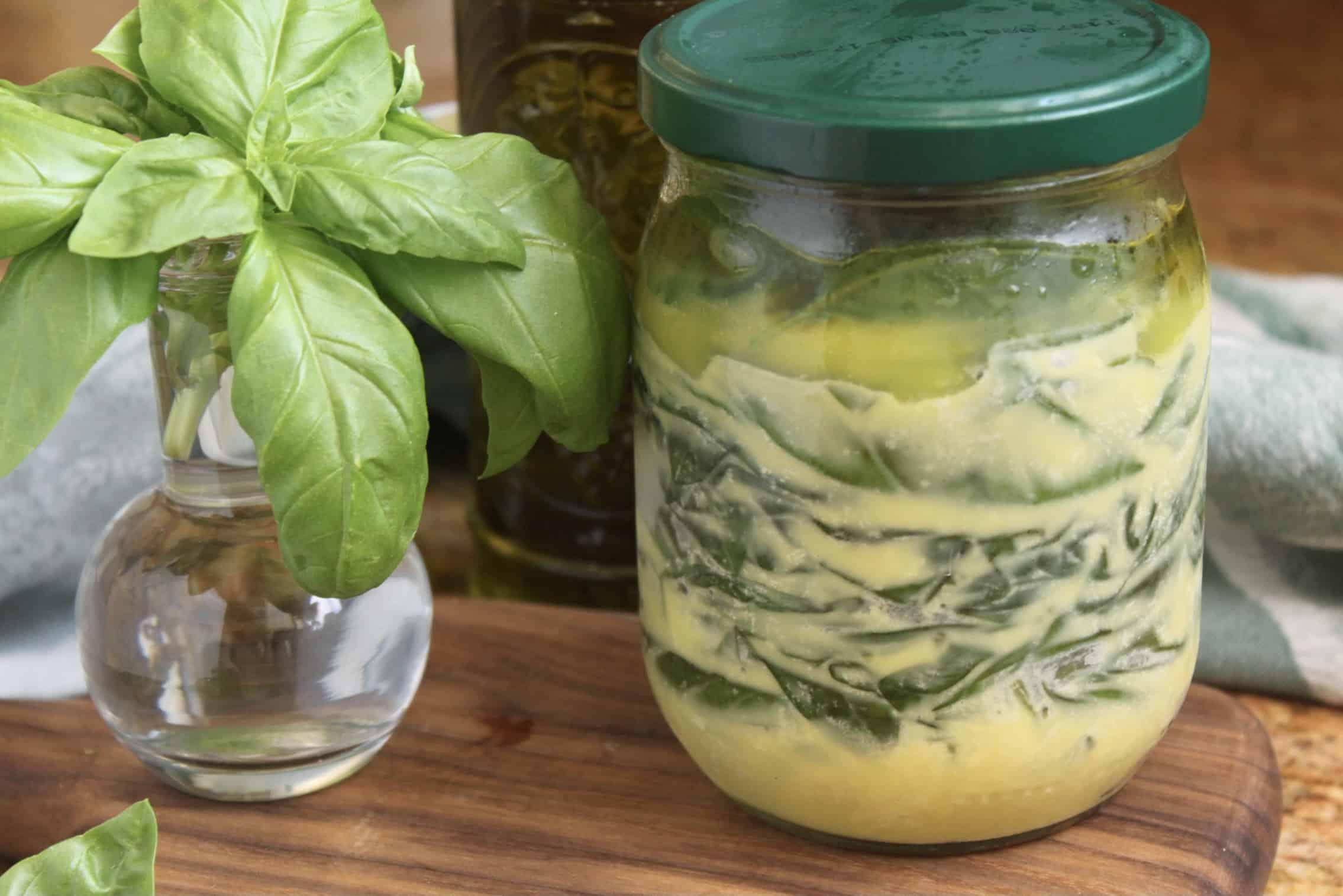 jar of herbs under oil