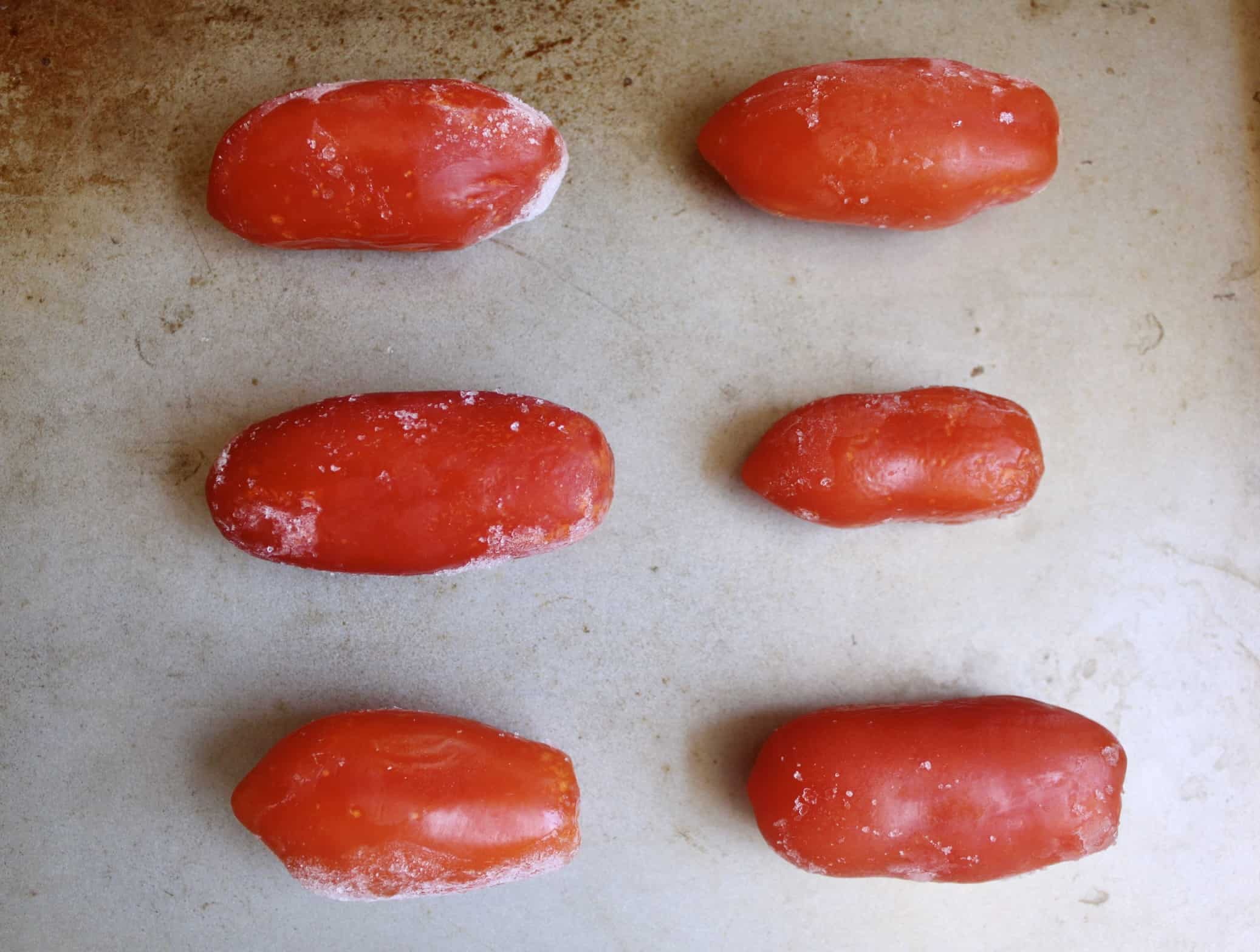 frozen tomatoes on a tray