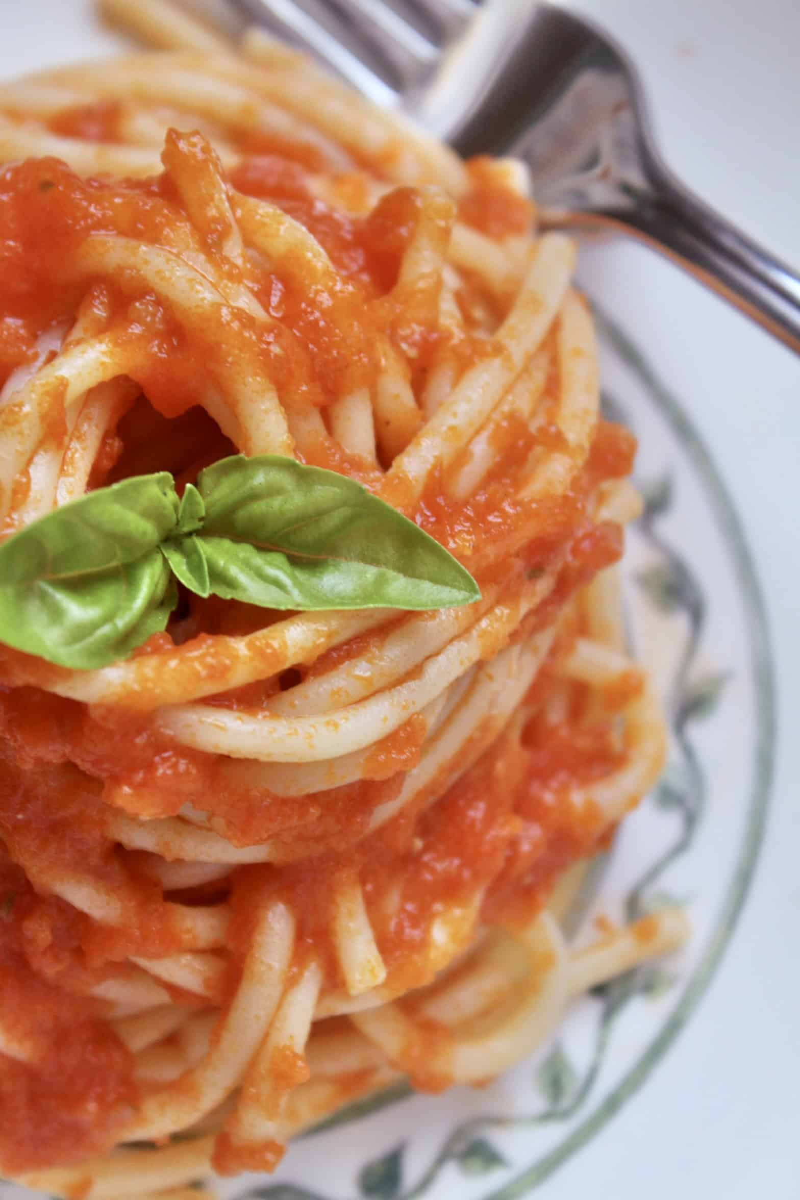 overhead shot of pasta with fresh tomato sauce