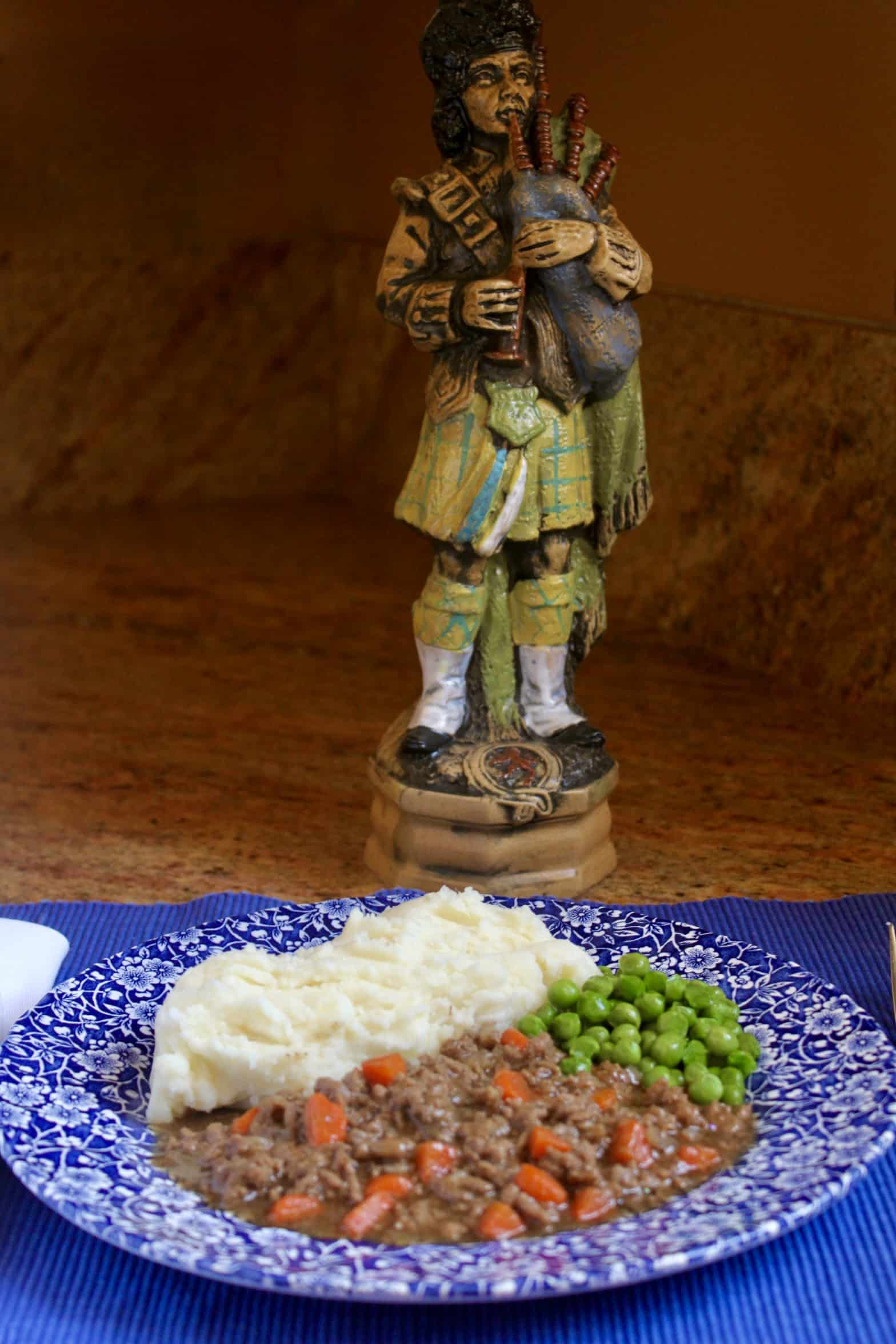 Mince and tatties with a piper in the background