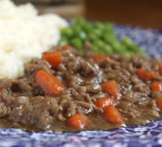 mince and tatties and peas on a floral plate