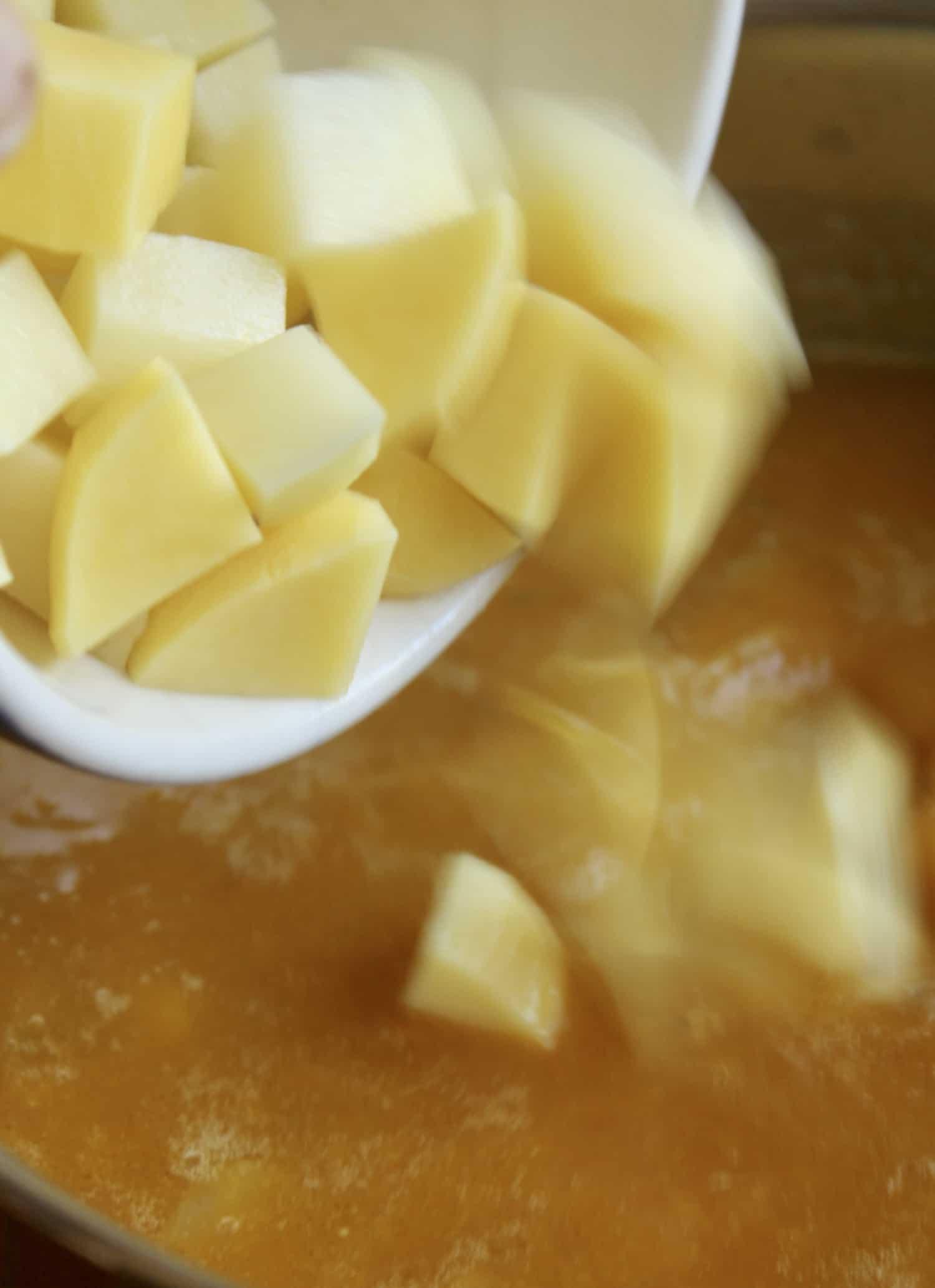 adding chunks of potatoes