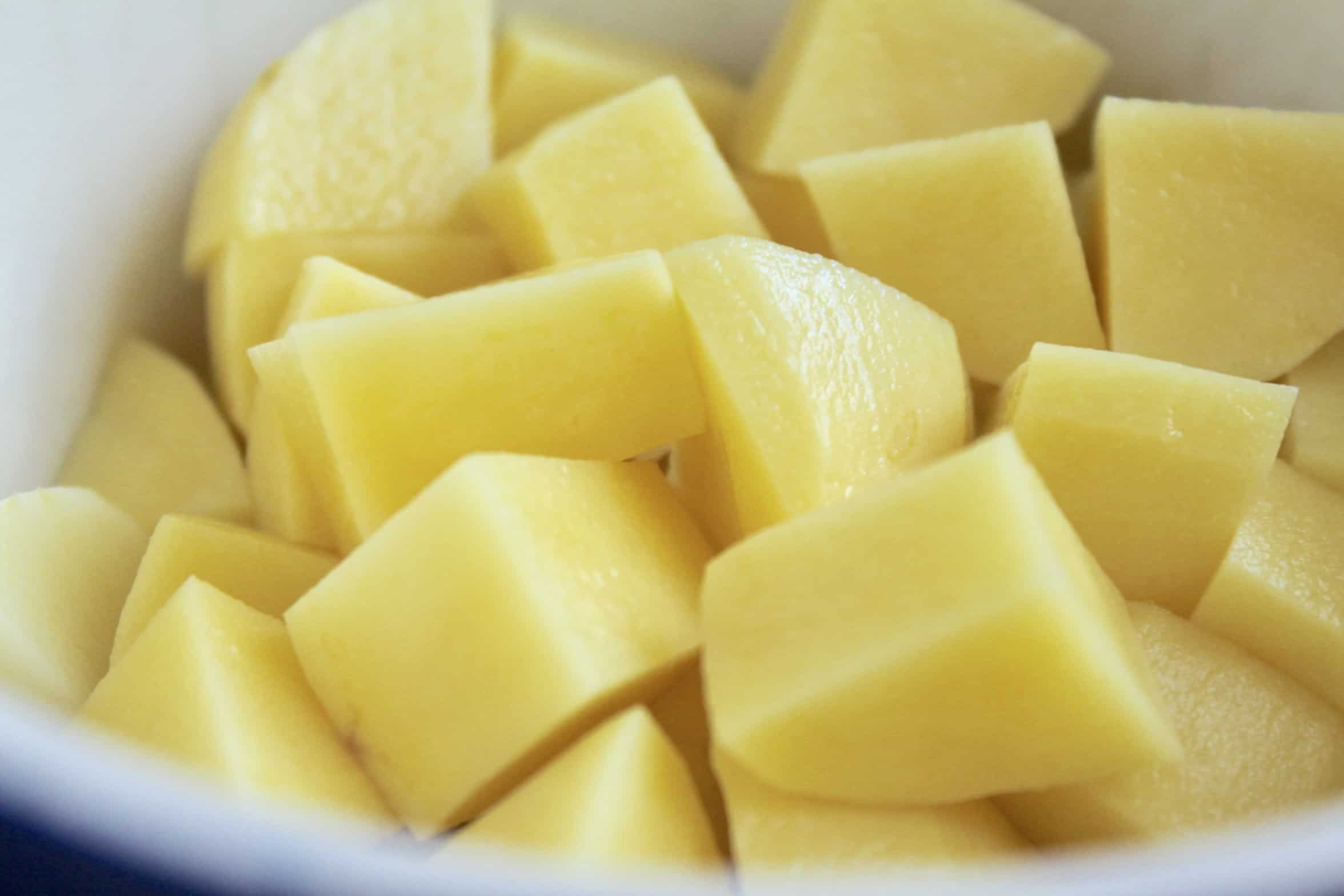 cubed potatoes in a bowl